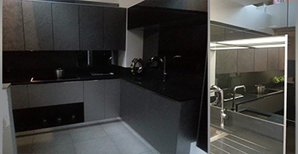 2 photos of black stone German kitchen for portfolio project on planning for extensions
