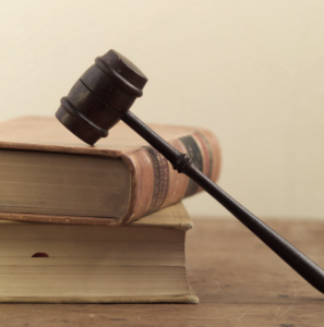 image of law books and judges hammer for article: planning consultant vs architect