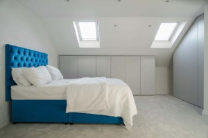blue bed with headboard in bedroom